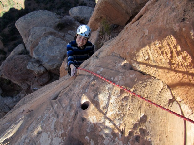 Karina climbing on Otto's Route. Note the hole, which would have originally had a metal pipe hammered into it.