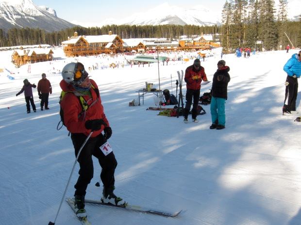 Racing is hard. Crossing the finish line at the Ken Jones Classic in Lake Louise with a bent pole, frozen water and an ice-coated face.